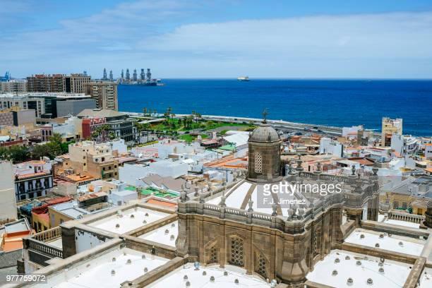 landscape of las palmas de gran canaria with the top of the cathedral - las palmas cathedral stock photos and pictures