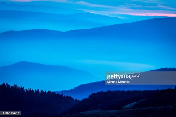 landscape of layers of mountain ridges and fog - stock image - foothills stock pictures, royalty-free photos & images