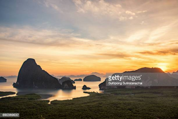 Landscape of limestone karsts in Phang nga bay at sunrise. Unseen place of 'Samed Nangshe' or 'Samet Nangchee' in Phang Nga province, Thailand.