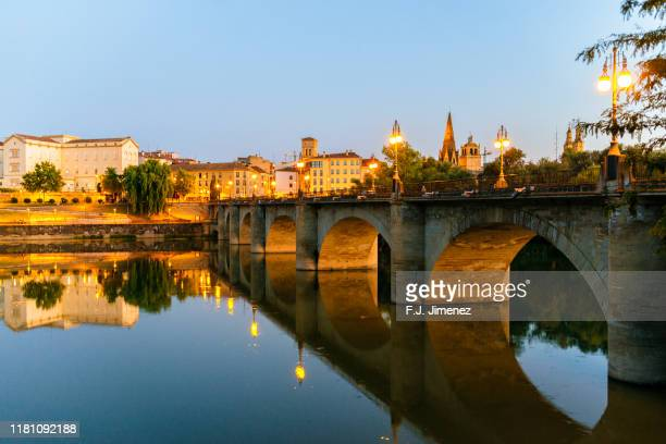 landscape of logroño with the ebro river at dusk - camino de santiago stock pictures, royalty-free photos & images