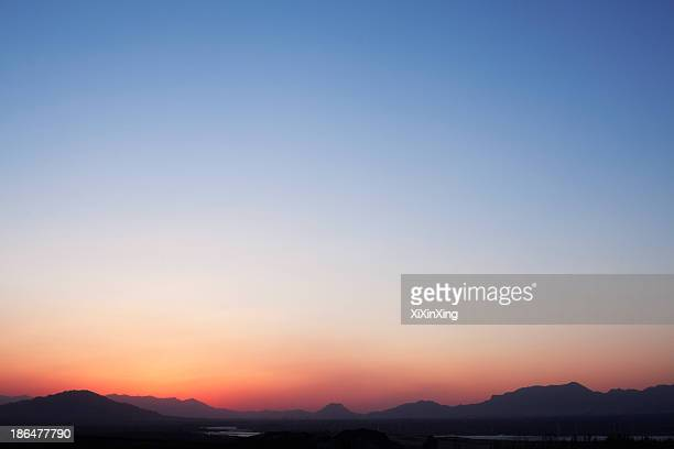 landscape of mountain range and the sky at dusk, china - heldere lucht stockfoto's en -beelden