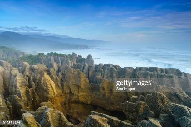 landscape of pancake rocks nearpunakaiki, new zealand - image stock pictures, royalty-free photos & images