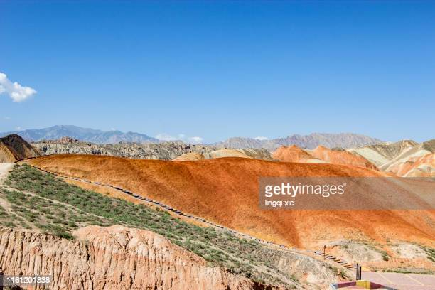 landscape of red rocky mountains in zhangye, gansu province, china - historical palestine stock pictures, royalty-free photos & images