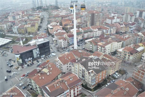 A landscape of residential buildings is seen as cable cars move on the line between Yenimahalle and Sentepe districts in Ankara Turkey on December 2...