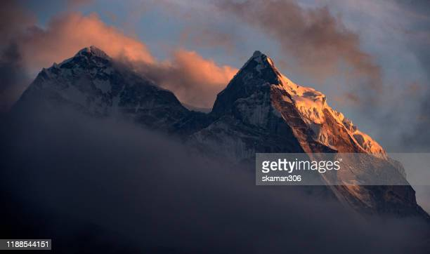 landscape of ridge of ama dablam mountain from dingboche village on the way to everest basecamp solukhumbu region nepal - k2 mountain stock pictures, royalty-free photos & images