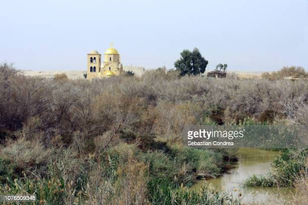 landscape of sacred jordanian valley, saint john the baptist greek orthodox church at jordan river, middle east, orient - religious celebration stock pictures, royalty-free photos & images