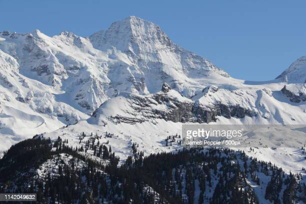 landscape of snowcapped mountains - james popple stock pictures, royalty-free photos & images