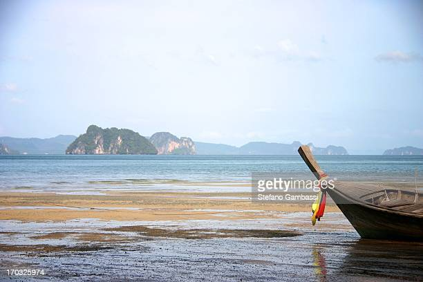 Landscape of Thailand sea with long tail boat in low tide.