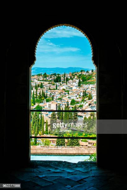 Landscape of the Albaicin neighborhood of Granada, seen through Arabic style window