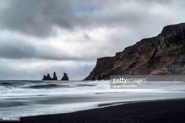 Landscape of the famous black sand beach on a cloudy day