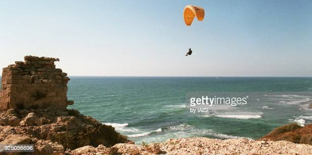 landscape of the mediterranean sea in spring with crusader ruins and a paraglider - sharon plain stock pictures, royalty-free photos & images