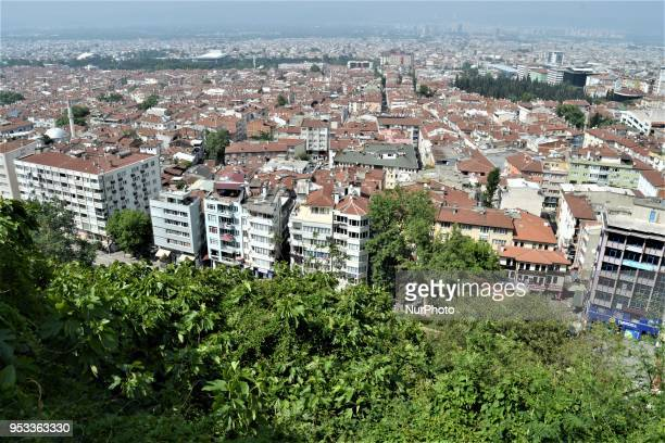 A landscape of trees and buildings is pictured from the terrace of Tophane Park in northwestern Bursa province of Turkey on May 1 2018 Turkey...