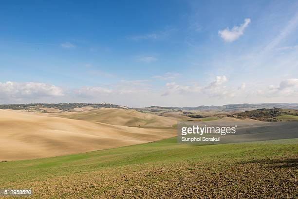 landscape of val d'orcin with farm lands on rolling hills - san quirico d'orcia stock pictures, royalty-free photos & images
