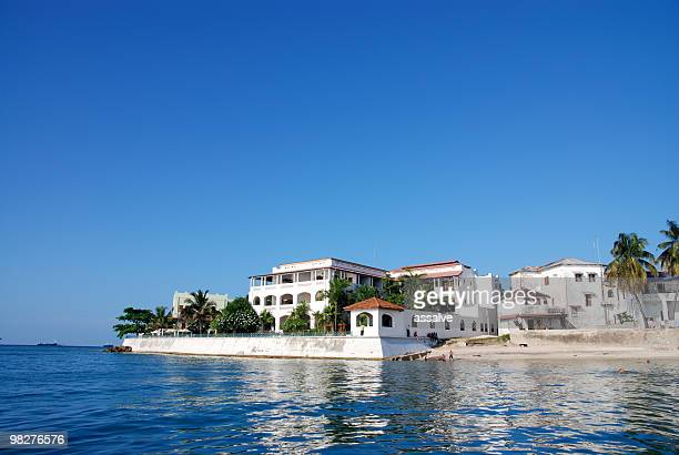 landscape of zanzibar stone town on a sunny day - zanzibar stock photos and pictures