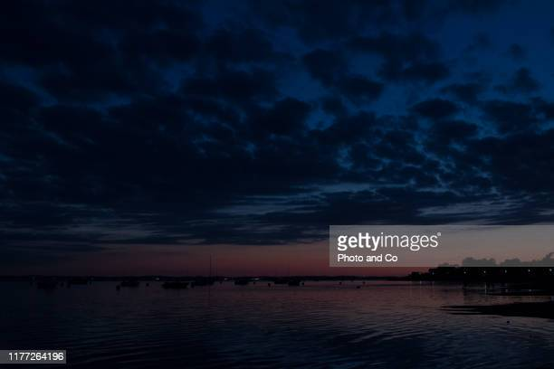 landscape on the sea shore after the sunset - blue hour stock-fotos und bilder