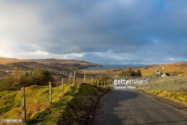 landscape over a village on isle of skye, scotland - town stock pictures, royalty-free photos & images