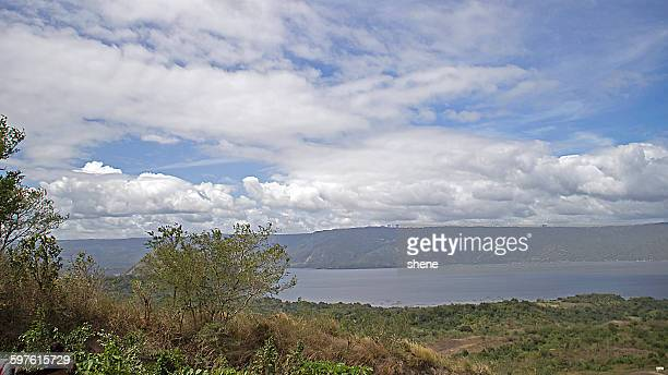 landscape over the lake taal - taal volcano stock photos and pictures