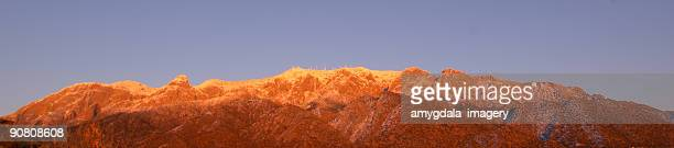 landscape panoramic winter mountain sunset - sandia mountains stock pictures, royalty-free photos & images