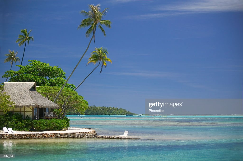 landscape photograph of a beautiful beach and hut in a tropical locale : Foto de stock