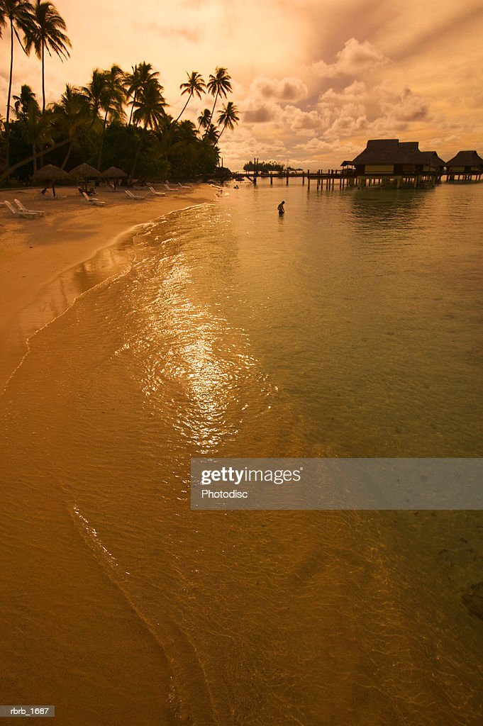 landscape photograph of a beautiful beach at sunset in tahiti : Stockfoto