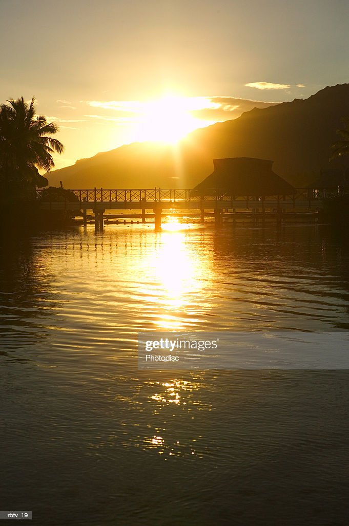 landscape photograph of a beautiful beach sunset at a tropical resort : Foto de stock