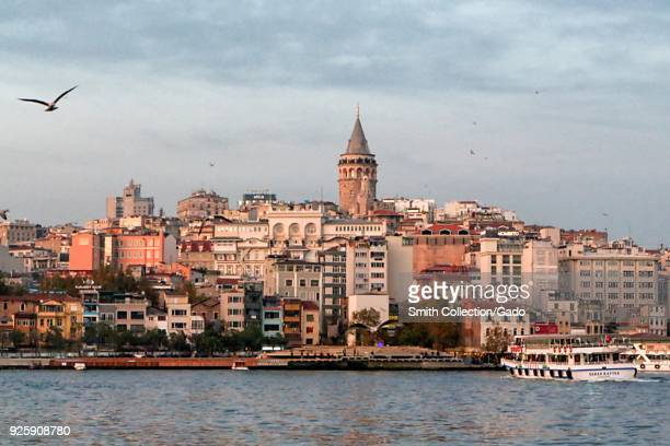 Landscape photograph of the Istanbul waterfront and Bosphorus Strait in the early morning, with the city skyline visible in the background, Istanbul,...