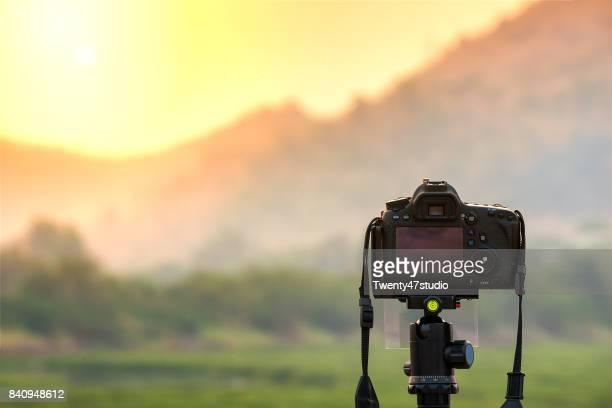 Landscape photographer, DSLR Camera outdoors