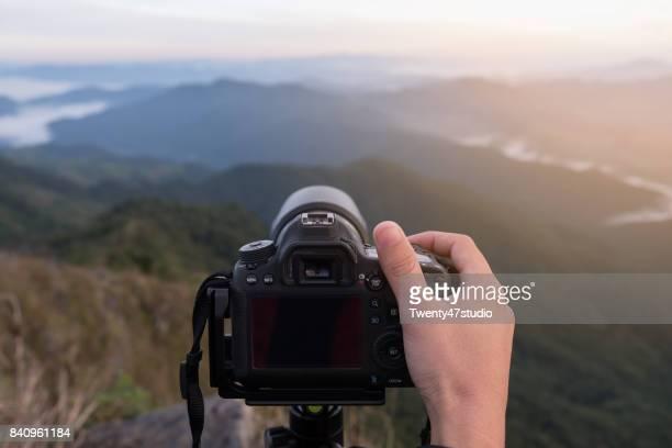 Landscape photographer, Hand on camera