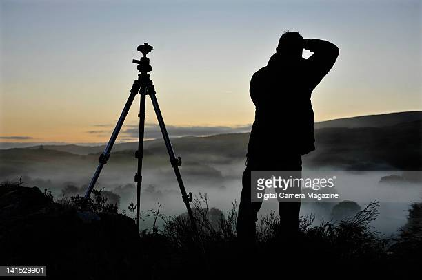 Landscape photographer taking pictures of a misty sunrise in Snowdonia taken on September 23 2008