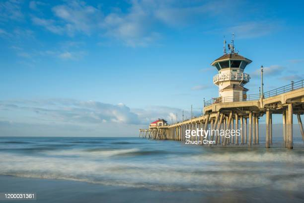 a landscape picture of huntington beach pier - huntington beach stock pictures, royalty-free photos & images