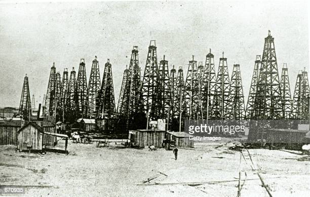 Landscape picture of oil derricks atop Spindletop Hill which was the site of Texas's first oil gusher January 10 1901 Beaumont in the southeast...