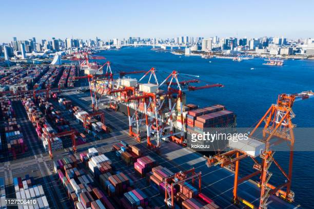 landscape picture of the container area in the evening. - moored stock pictures, royalty-free photos & images