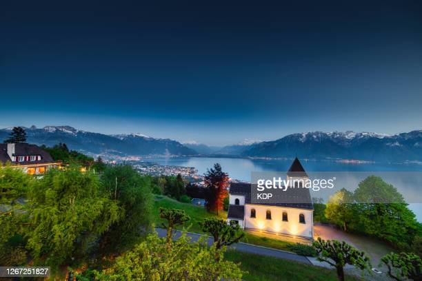 landscape scenery view with beautiful lake geneva and little church of mont pelerin vevey, switzerland. - montreux stock pictures, royalty-free photos & images