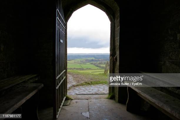 landscape seen through archway - arch stock pictures, royalty-free photos & images