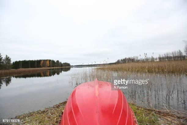 landscape shot of red rowing boat