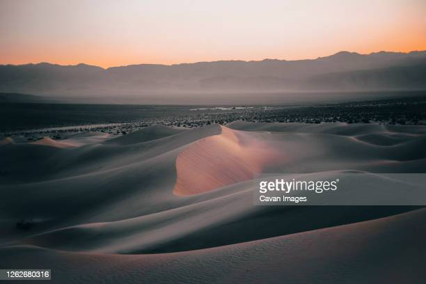 landscape shot of sand dune in death valley during blue hour - colorado stock pictures, royalty-free photos & images