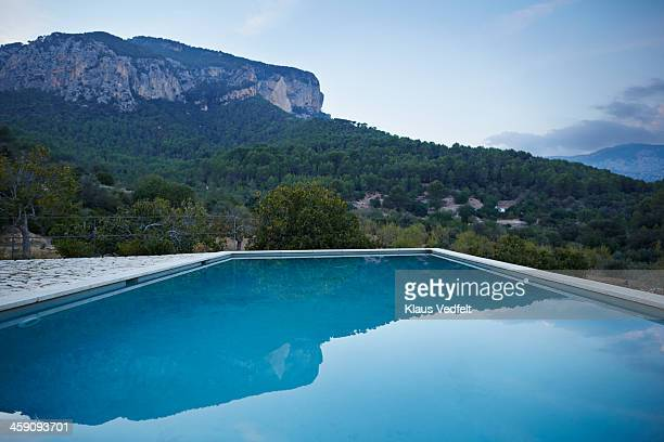 landscape shot of swimming pool in mountain area - klaus vedfelt mallorca stock pictures, royalty-free photos & images