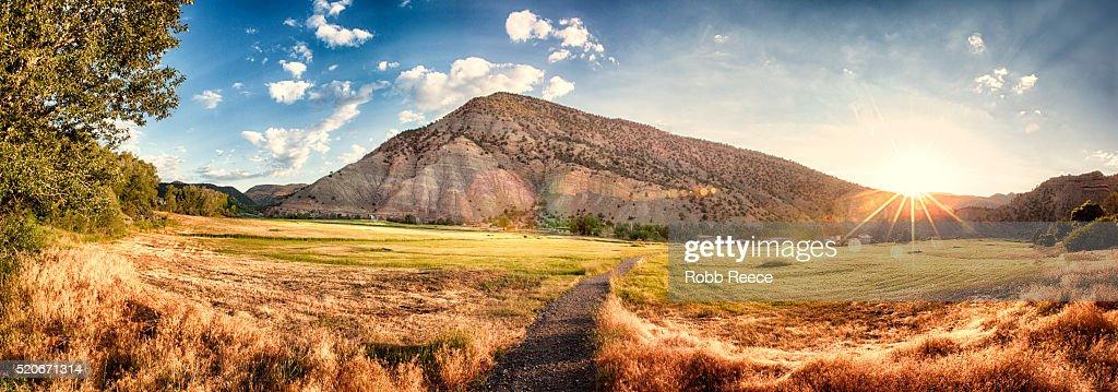 Landscape sunrise with sunburst over a field in Colorado : Stock Photo