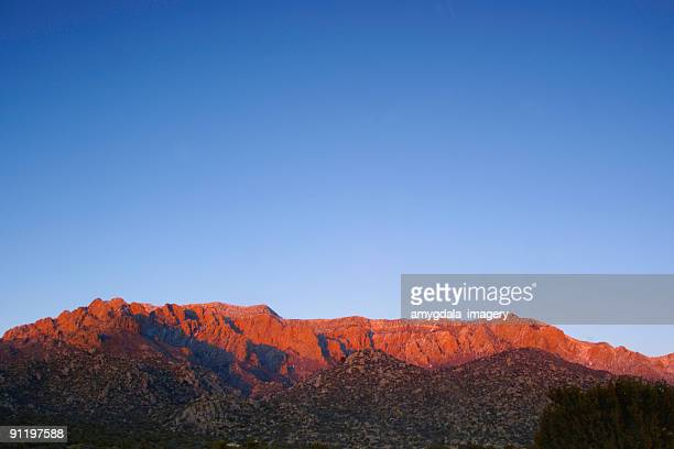 landscape sunset mountain red with blue sky - sandia mountains stock pictures, royalty-free photos & images