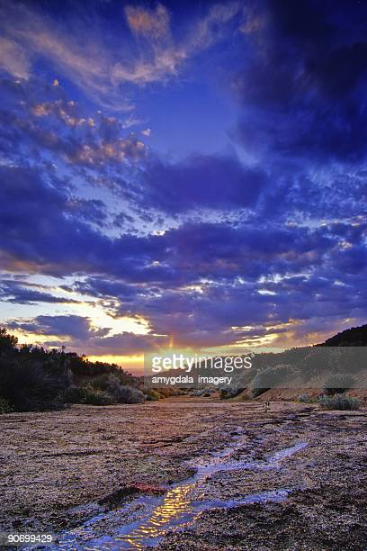 landscape sunset sky stream reflection - sandia mountains stock photos and pictures