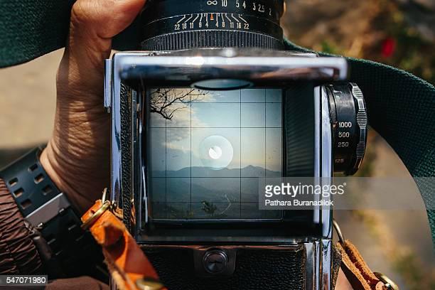 Landscape through viewfinder of medium format film camera