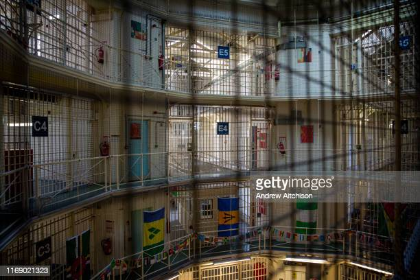 Landscape view across the central hall to the multiple levels of Wing C and E and of Her Majestys Prison Pentonville London United Kingdom...