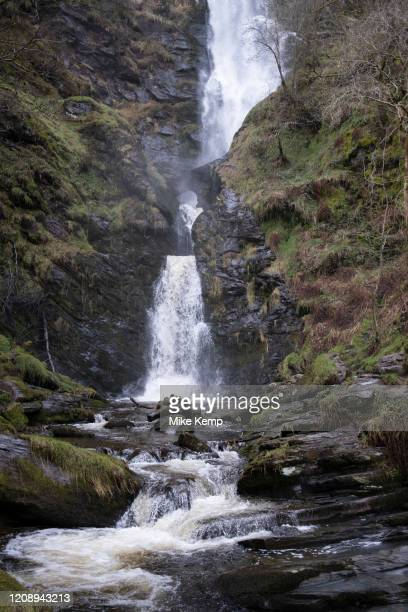 Landscape view at the bottom of Pistyll Rhaeadr waterfall in Llanrhaeadr-ym-Mochnant, Wales, United Kingdom. Pistyll Rhaeadr, meaning spring of the...