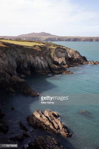 Landscape view looking out across rocks and headland out to sea at St Davids Head near St Davids Pembrokeshire Wales United Kingdom
