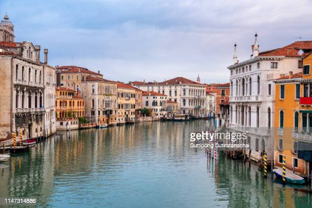 landscape view of canal bridge and building in early morning with no people no tourist as beautiful amazing view and attraction in venice , italy - canal stock pictures, royalty-free photos & images