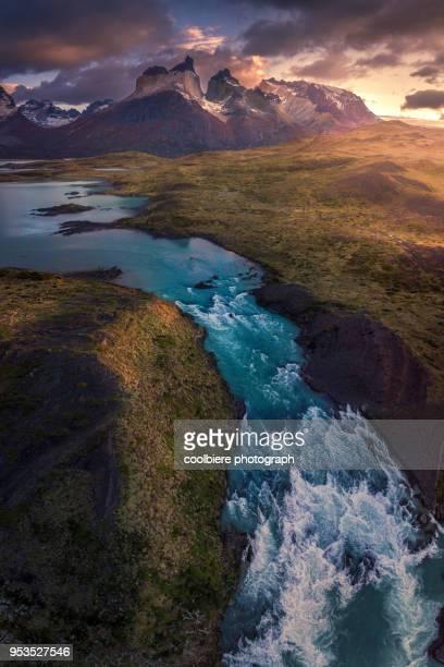 landscape view of magallanes with salto grande foreground - patagonische anden stock-fotos und bilder
