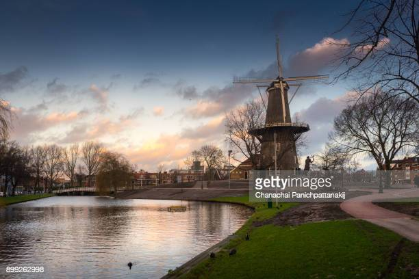 Landscape view of Rijnsburgersingel canal and Molen De Valk in Leiden, Netherlands