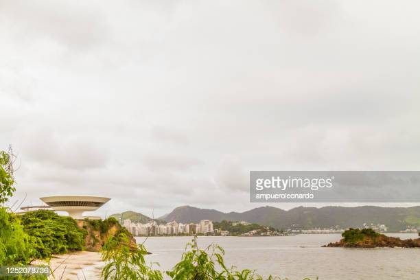 landscape view of rio de janeiro and niteroi city included niteroi contemporary art museum, brazil - niemeyer museum of contemporary arts stock pictures, royalty-free photos & images