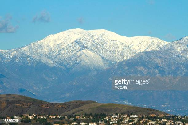 landscape view of snow-capped mt. baldy and nearby town - corona stock pictures, royalty-free photos & images