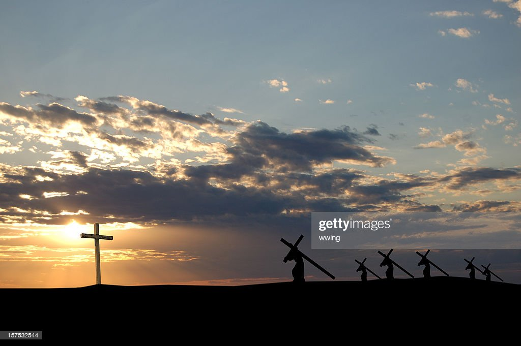 Landscape view of the sun and crosses being carried : Stock Photo
